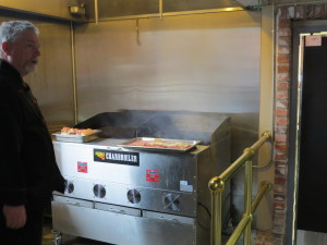 "48"" Charbroiler under a hood at TS Fork Restaurant"